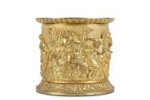 A FIRST HALF 19TH CENTURY FRENCH GILT BRONZE CACHE POT  of cylindrical form, the body cast in relief with a continuous classical style frieze of a hunting scene with Diana and her attendants and various hounds, on an acanthus cast foot,  18cm high x 19cm diameter