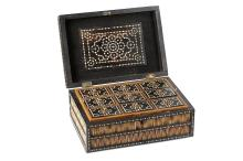 A 19TH CENTURY ANGLO INDIAN PORCUPINE QUILL AND IVORY INLAID EBONY WRITING BOX  of rectangular form decorated throughout with ivory circles, the hinged lid with decorative geometric panel to the inside, and with removable tray containing nine compartments with lids with brass handles,  13cm high x 33cm wide   THIS LOT IS SUBJECT TO CITES