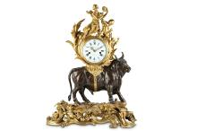 AMENDED: A LARGE AND IMPRESSIVE MID 19TH CENTURY LOUIS XV STYLE GILT AND PATINATED BRONZE MANTEL CLOCK DEPICTING A BULL SIGNED MICHEL BALTHAZAR, PARIS the mid 19th century case surmounted by a gilt bronze group of Venus and Cupid amongst laurel leaf and reed foliage, raised on a model of a bull, on naturalistic base over a pierced Rococo style plinth cast with C scrolls and foliage, the signed, white enamelled 6.5