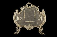 A LATE 19TH CENTURY FRENCH LOUIS XV STYLE GILT BRONZE FIRESCREEN  in the Rococo taste, the frame decorated with trellis-work, C scrolls and acanthus leaves, and raised on pierced, scrolling feet, the mesh with putti mounts and trailing flowers,  71cm high x 66cm wide