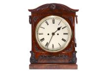 A MID 19TH CENTURY ENGLISH FUSEE BRACKET / TABLE CLOCK WITH PULL REPEAT  the arched case with stylised foliate carving, the sides with brass reticulated sound frets and ring handles, the painted dial with Roman numerals the twin fusee movement striking on a bell, with heavy brass bob pendulum,   40cm high   The movement is winding, ticking and striking and the pull repeat works but the clock is not fully tested or guaranteed.