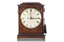 A REGENCY MAHOGANY AND BRASS MOUNTED TABLE / BRACKET CLOCK WITH PULL REPEAT BY GRANT, FLEET ST, LONDON  the pagoda top over the dentil moulded cornice and dentil plinth base, the sides with brass reticulated sound frets and gilt foliate swing handles, on four ball feet, the painted dial signed 'GRANT Fleet St. LONDON', the backplate also signed, the twin fusee movement striking on a bell, with pendulum,   John Grant of Fleet Street, London (the son of John Grant, also of Fleet Street) was born in 1796. He was liveryman of the Clockmakers Company in 1817 and Master 1838-1867.