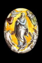 A 16TH CENTURY STAINED GLASS PANEL DEPICTING THE ASSUMPTION OF THE VIRGIN  of oval form, the Virgin with long flowing hair, her hands in prayer and flanked by four angels,mounted in a modern black frame with electric light within to illuminate,  the glass 23cm high, the frame 37cm