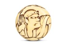 A MARINE IVORY MANJU NETSUKE.  19th Century.  Engraved in low relief with a bust portrait of a man, possible a kabuki actor, faint signature, ascribed to Michitane, 4.5cm diameter.  Provenance: Private Collection, acquired from Eskenazi, London, 7 December 1979.  ???????? ? ???