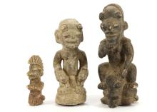 TWO NOMOLI STONE FIGURES, SIERRA LEONE  One figure riding a bovine animal, 22cm high, and the other figure holding an animal in each hand, 19cm;and another stone figure, 11.5cm (3)