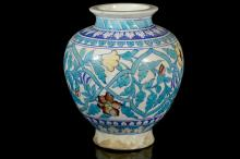 AN IZNIK POTTERY VASE  Circa 19th Century  Decorated with floral motifs, 30cm high