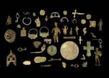 A MISCELLANEOUS GROUP OF ANCIENT BRONZES  Circa 1st Millennium B.C. to Byzantine Period  Including a Roman head wearing a Corinthian helmet, a Roman tinned bronze disc, four keys, a Byzantine reliquary cross, and other items, 2cm-11cm long; and a group of bronze items, Not Ancient (a lot)  Provenance: Mr and Mrs S. Broukal Collection, formed in the 1950s, in the UK since 1956. Thence by descent.