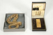 An early 1980's Dunhill gold plated lighter in original box and paperwork, together with a boxed Butler & Wilson gold plated necklace by Selfridges (2).