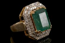 An 18ct gold, emerald and diamond set cluster dress ring.