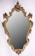 A late 19th Century / early 20th Century baroque form giltwood mirror, 110cm high x 64cm wide.