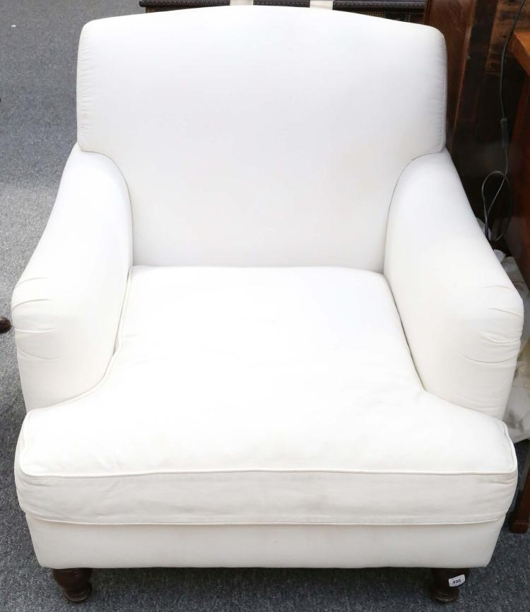 A modern howard style armchair with loose cover on turned f for Modern armchair covers