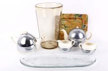 A collection of mid 20th Century and later items, to include a large smoked glass Whitefriars vase, two Celtic England teapots, together with a sugar bowl and milk jug, a large glass fish platter and a slipware earthenware tray (7).