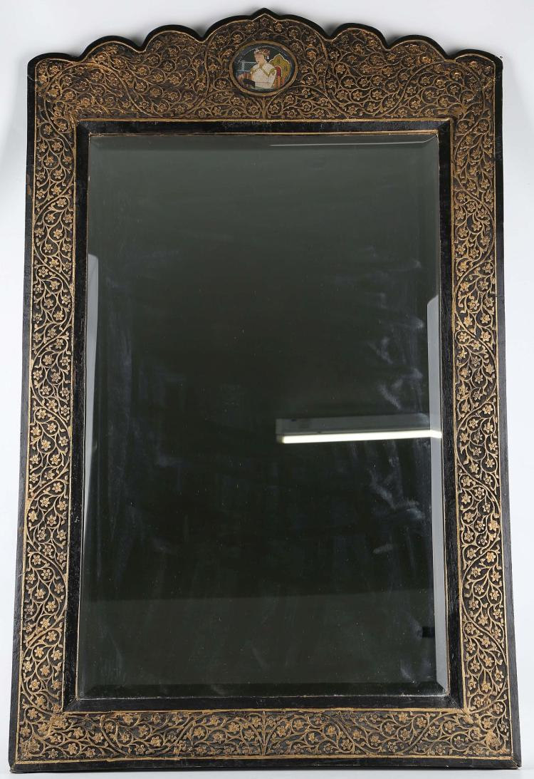 A Large Carved Indian Wall Mirror With Gold Painted Foliate