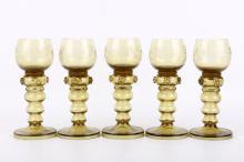 A set of five 19th Century glass wine roemers, of olive green tint, the bowls engraved with vine decoration, raised on hollow knopped steins applied with four raspberry prints (5).