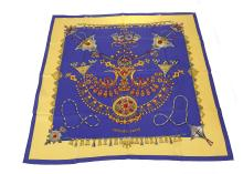 Hermes 'Parures des Sables' silk scarf, designed in 1988 byLaurence Bourthoumieux, on royal blue and yellow ground, 90cm x 90cm, with original cardboard sleeve