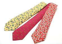 Three Hermes whimsical silk ties, to include a red ground cotton wool ball example, a yellow ground watermelon example, and a maroon ground leopard example, (3)