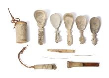 A GROUP OF INUIT ITEMS   Including five scrimshaw walrus ivory or bone spoons, four of which with figures of elk; a cylindrical vessel with a band of geometric design to the top and bottom, and the figure of an elk in the centre; and seven further assorted pieces of walrus ivory and/or bone, 11.3cm - 14cm long, (13)  This item may require Export or Cites licences in order to leave the UK or the European Union. It is the buyer's responsibility to ensure that lots have the relevant licences before shipping.