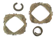 TWO YORUBA BRONZE RATTLES, NIGERIA Two square form anklet rattles with rounded edges, decorated with foliate motifs; A piece of Manilla currency, and further piece of currency, 6.5 - 15.7cm, (4)  Provenance: The property from the collection of Siegfried Soucek, acquired between 1968 and 1972.