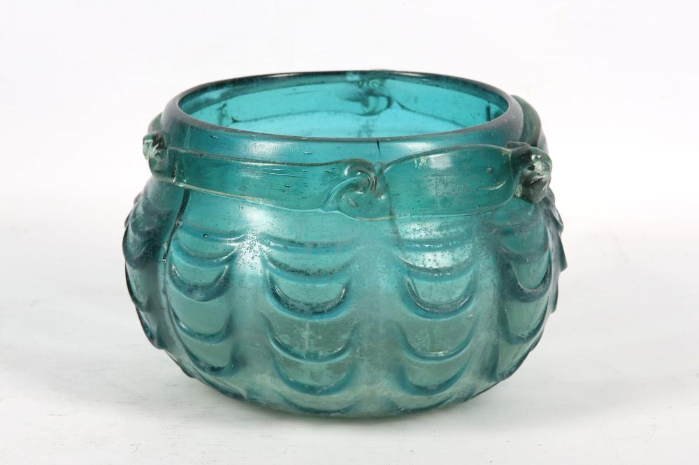 AN EARLY ABBASID DEEP GREEN HOT-WORKED GLASS BOWL