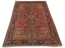 An early to mid 20th Century Persian Heriz carpet, North West Iran, 3.30m x 2.40m, condition rating B.
