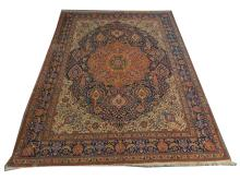 A signed early 20th Century Persian Tabriz carpet, North West Iran, 4.07m x 3.09m, condition rating C.