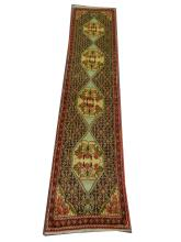 A Persian Senneh runner, West Iran, 2.37m x 0.53m, condition rating A.
