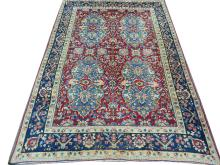 A mid 20th Century Persian Kerman carpet. 4.30m x 2.90m, condition rating B.