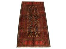 A Persian meshed Belouch rug, North East Iran, 1.98m x 1.05m, condition rating A.