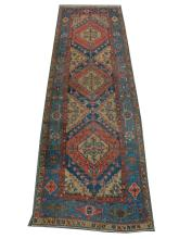 A mid 20th Century Persian Heriz runner, North West Iran, 3.10m x 1.04m, condition rating b.