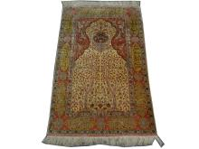 A fine Turkish silk Hereke rug with metal thread, 1.61m x 1.03m, condition rating A.