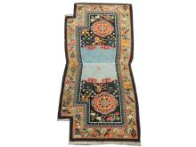 An early 20th Century Tibetan saddle rug, 1.25m x 0.62m, condition rating A/B.