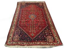 A mid 20th Century Persian Qashqai carpet, South West Iran, condition rating B.