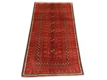 A Persian Turkoman rug, North East Iran, 2.12m x 1.15m, condition rating A/B