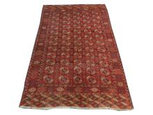 An early 20th Century Turkoman Bokhara carpet, 2.97m x 1.96m, condition rating B/C.