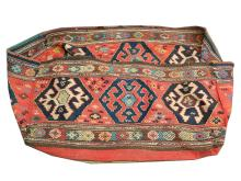 An early 20th Century Persian Shahsavan cradle, 1.00m x 0.60m, condition rating B.