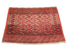 An early 20th Century Turkoman Juval rug, 1.32m x 0.90m, condition rating B.