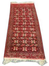 A mid 20th Century Turkoman rug, 2.34m x 1.13m, condition rating A/B.