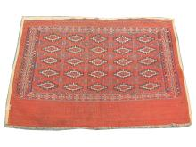An early 20th Century Turkoman Juval rug, 1.07m x 0.71m, condition rating A/B.