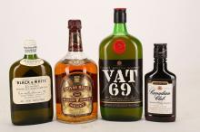 A late 1960's bottle of Buchanan's 'Black and White' Scotch Whisky, 37.5cl (43% ABV), a 1990's VAT 69 Scotch Whisky, 70cl (ABV unknown), a Canadian Club, 200ml (40% ABV), and a 1960's Chivas Regal 12 year old blended Scotch Whisky, one quart (ABV unknown) (4).