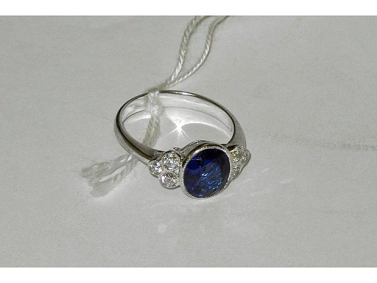 An 18ct white gold, sapphire and diamond set ring,