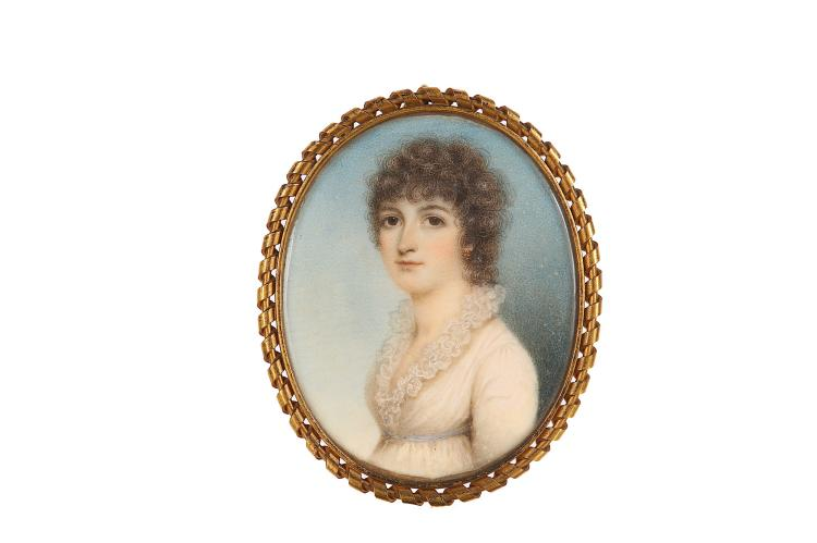 NATHANIEL PLIMER (ENGLISH 1757-1822) Portrait miniature of a Lady in white dress with frilled neckline and blue ribbon waistband, curled brown hair Watercolour on ivory Gilt metal frame with scrolling decorative border Oval, 70mm high Subject to CITES