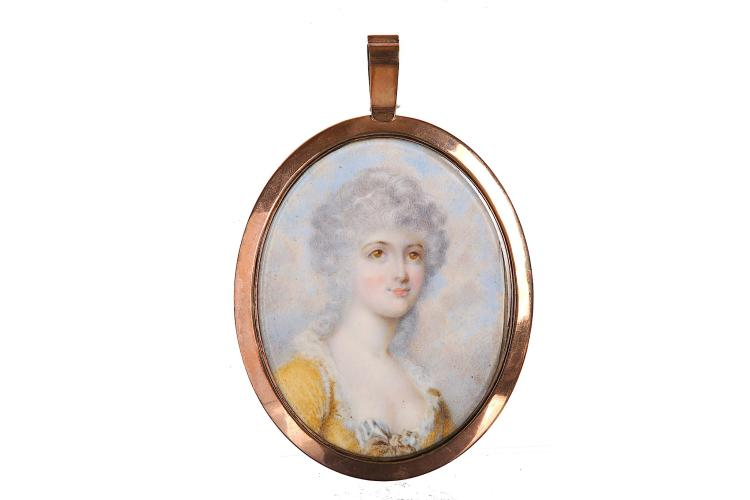ATTRIBUTED TO ARCHIBALD SKIRVING (BRITISH 1749-1819) Portrait miniature of a Lady wearing a yellow décolleté dress with lace trim and bow at her corsage Watercolour on ivory Gold frame, the reverse with glazed aperture to reveal green silk Oval, 63mm high Subject to CITES