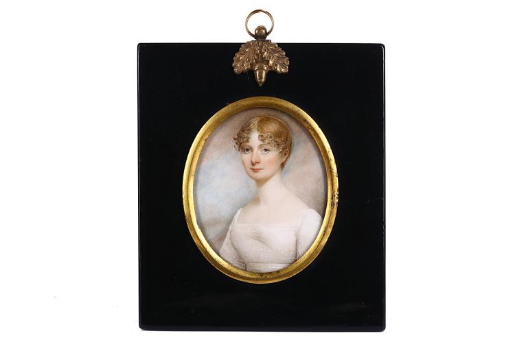 ENGLISH SCHOOL (c.1810) Portrait miniature of a lady in white dress with upswept curling fair hair, cloud and sky background Watercolour on ivory Rectangular black lacquer frame with gilt metal mount Oval, 75mm high Subject to CITES