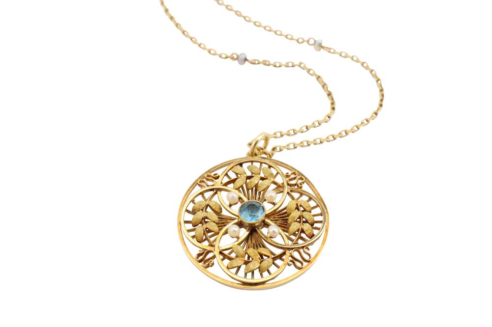 A gem-set pendant and chain