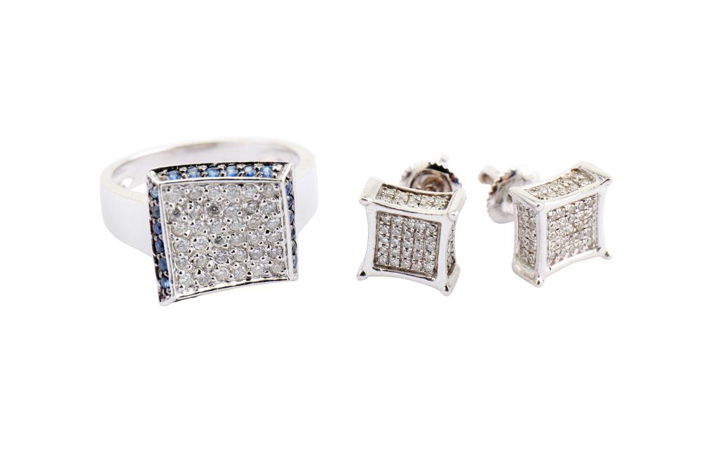 A sapphire and diamond ring and a pair of diamond earrings