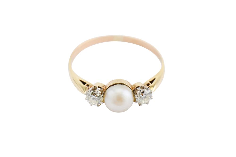 A half-pearl and diamond ring