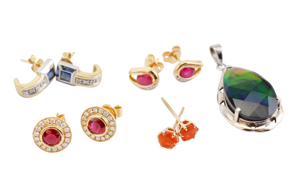 A group of earrings and a pendant