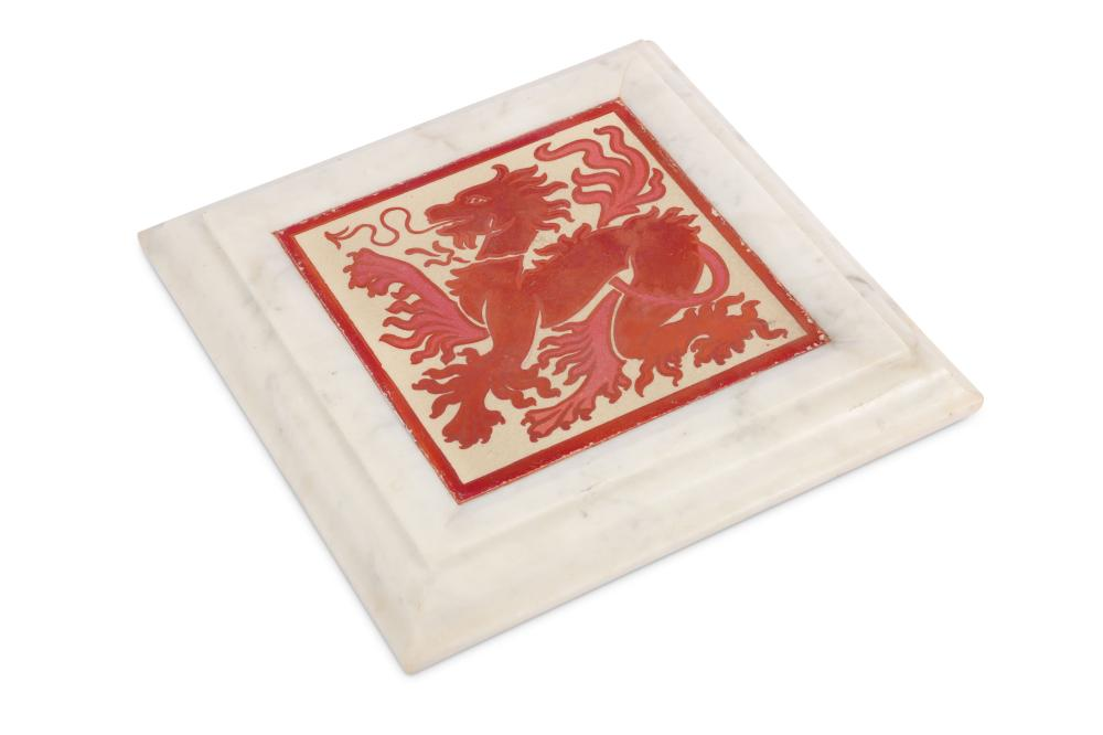 In the manner of William De Morgan - a red lustre tile