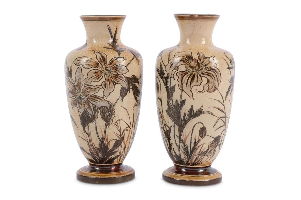 A pair of pair of Martin Brothers stoneware vases of baluster form dated 1892