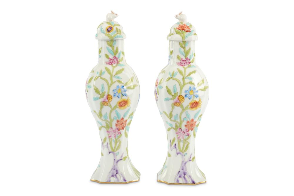 A pair of Herend Hungarian porcelain vases and covers